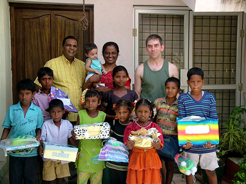Chennai children holding the gifts they received from their sponsors in Ireland